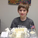student with his ice castle