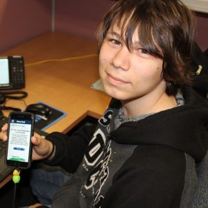 Seth Albertus from NCCS and Upward Bound shows off a working application on an android device.